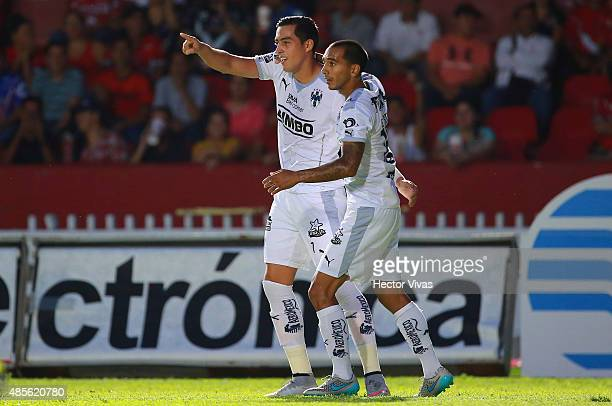 Rogelio Funes Mori of Monterrey celebrates with teammates after scoring the first goal of his team during a 7th round match between Veracruz and...