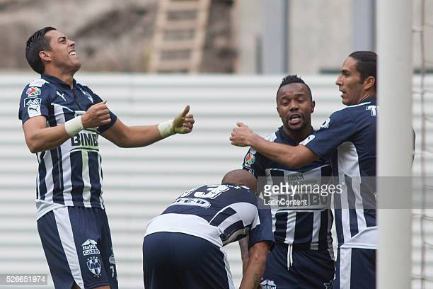 Rogelio Funes Mori of Monterrey celebrates with teammates after scoring the third goal of his team during the 16th round match between America and...