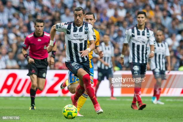 Rogelio Funes Mori of Monterrey drives the ball during the quarter finals second leg match between Monterrey and Tigres UANL as part of the Torneo...
