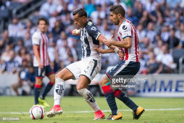 Rogelio Funes Mori of Monterrey fights for the ball with Jair Pereira of Chivas during the 4th round match between Monterrey and Chivas as part of...