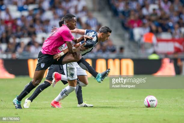 Rogelio Funes Mori of Monterrey fights for the ball with Oscar Murillo of Pachuca during the 13th round match between Monterrey and Pachuca as part...