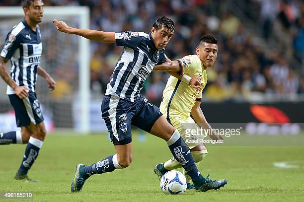 Rogelio Funes Mori of Monterrey fights for the ball with Osvaldo Martinez of America during the 16th round match between Monterrey and America as...