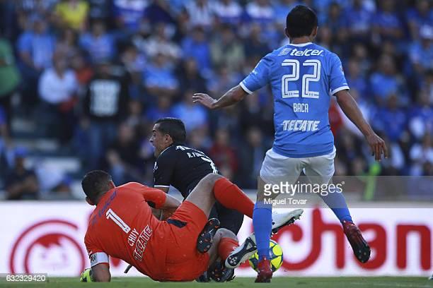 Rogelio Funes Mori of Monterrey is fouled by Jesus Corona of Cruz Azul during a match between Cruz Azul and Monterrey as part of the Clausura 2017...