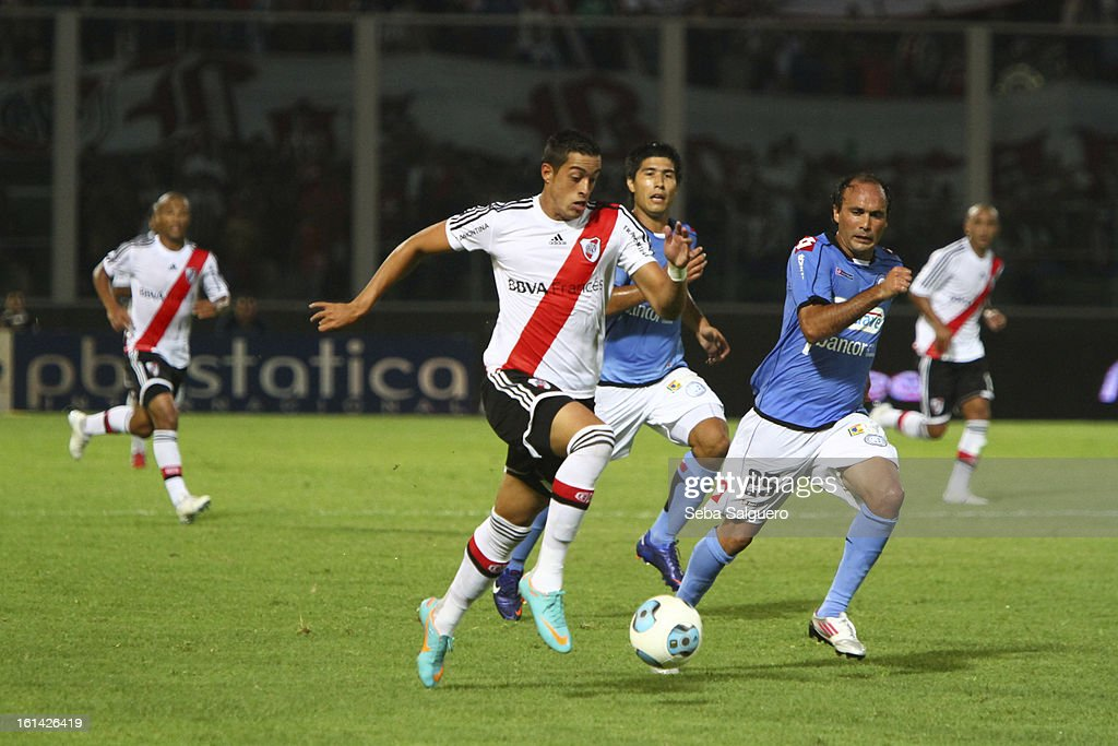 Rogelio Funes Moris of River fights for the ball with Gaston Turus of Belgrano during the match between Belgrano and River for the Torneo Final 2013 on February 10, 2013 in Cordoba, Argentina.