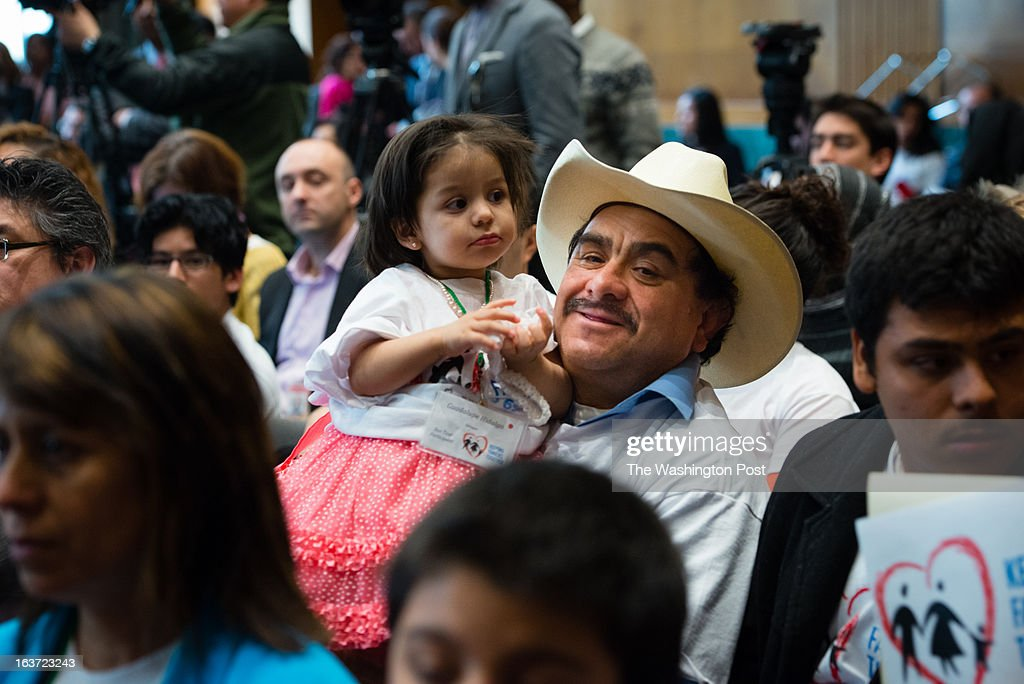 Rogelio Hidalgo, 48, of Mexico holds his 18-month-old daughter, Lupita Hidalgo. The father, who is undocumented and is waiting for the reform, lives in Redmond, OR. Immigrant families, some of who participated in a 3-week bus tour aimed at keeping families together, came to Capitol Hill on Wednesday demanding legislation with a path to citizenship. A people's hearing on immigration reform was held where immigrants gave testimony on their stories for the audience and panel including some congressmen including Luis Gutierrez, Bill Foster, Mike Honda, Juan Vargas, Steven Horsford and Cangresswoman Judy Chu. The group gave senate a March 21 deadline to introduce immigration legislation.