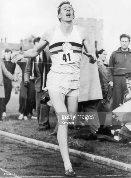 Roger Bannister crossing the tape at the end of his record breaking mile run at Iffley Road Oxford He was the first person to run the mile in under...