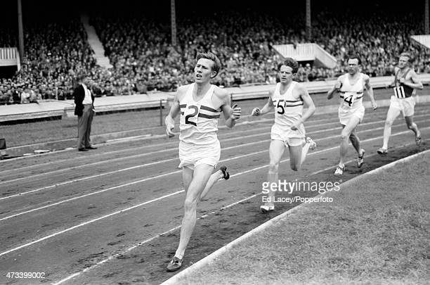 Roger Bannister of Great Britain leading Christopher Chataway and Christopher Brasher of Great Britain during a 2 mile British Record attempt at the...