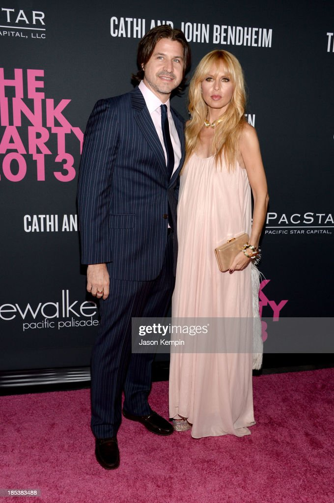 Roger Berman and fashion stylist Rachel Zoe attend Elyse Walker Presents The Pink Party 2013 hosted by Anne Hathaway at Barker Hangar on October 19, 2013 in Santa Monica, California.