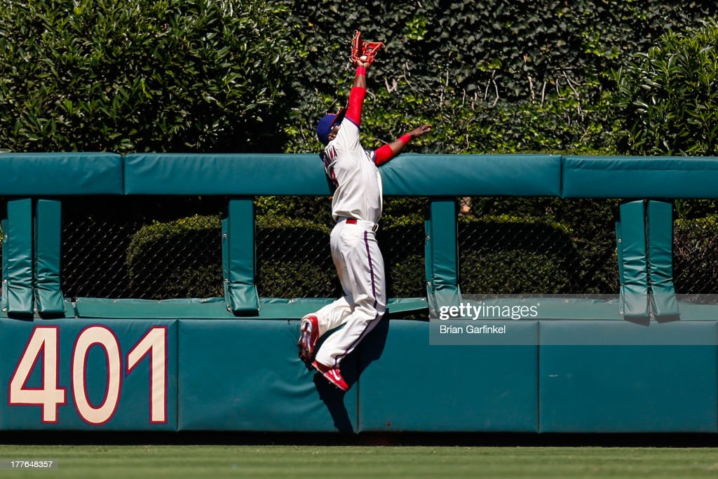 <a gi-track='captionPersonalityLinkClicked' href=/galleries/search?phrase=Roger+Bernadina&family=editorial&specificpeople=4246414 ng-click='$event.stopPropagation()'>Roger Bernadina</a> #3 of the Philadelphia Phillies catches a long fly ball at the home run fence in the third inning of the game against the Arizona Diamondbacks at Citizens Bank Park on August 25, 2013 in Philadelphia, Pennsylvania.