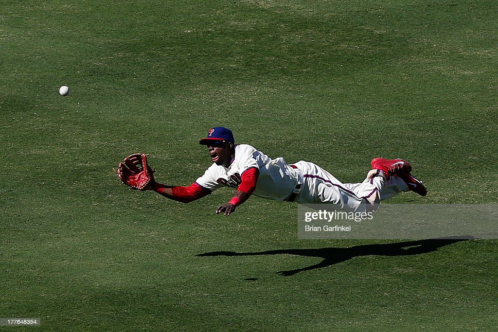 Roger Bernadina #3 of the Philadelphia Phillies dives to catch a long fly ball to close out the seventh inning of the game against the Arizona Diamondbacks at Citizens Bank Park on August 25, 2013 in Philadelphia, Pennsylvania.