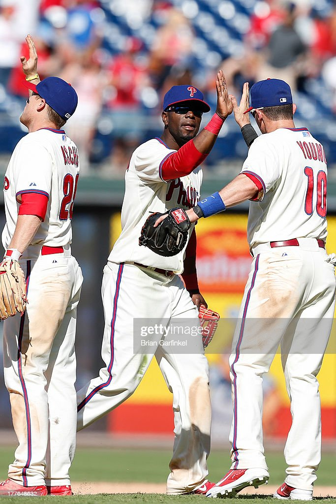 <a gi-track='captionPersonalityLinkClicked' href=/galleries/search?phrase=Roger+Bernadina&family=editorial&specificpeople=4246414 ng-click='$event.stopPropagation()'>Roger Bernadina</a> #3 of the Philadelphia Phillies high fives teammates after the game against the Arizona Diamondbacks at Citizens Bank Park on August 25, 2013 in Philadelphia, Pennsylvania. The Phillies won 9-5.