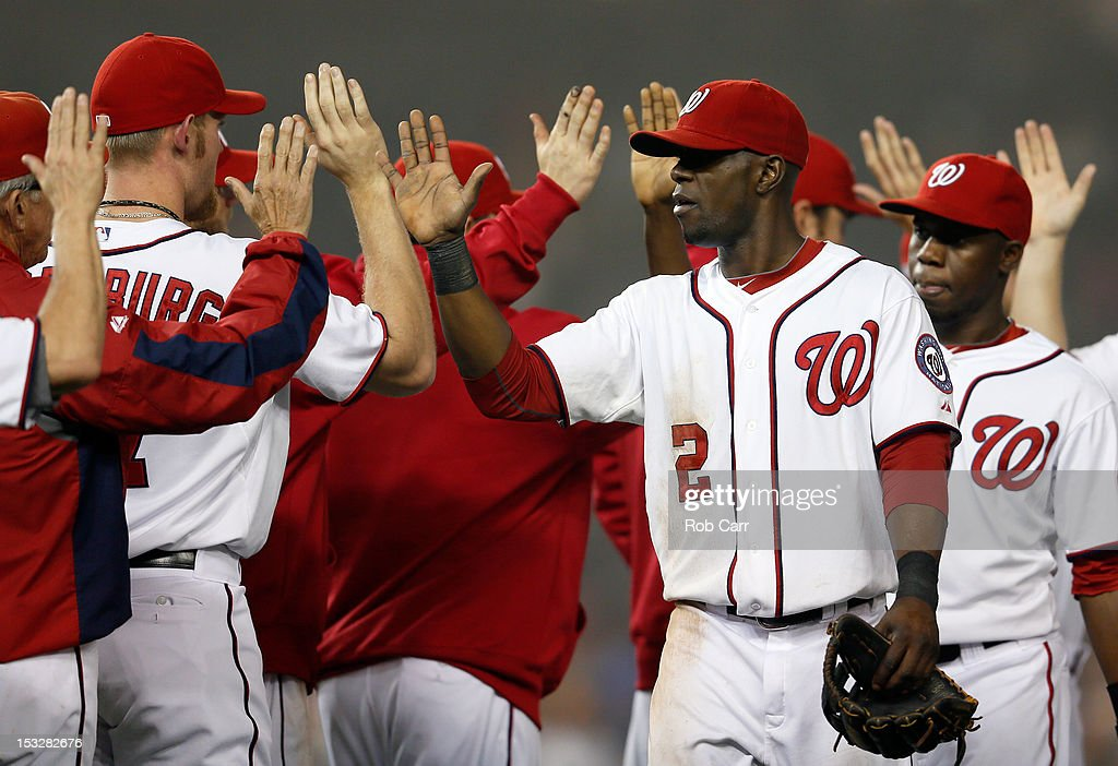 <a gi-track='captionPersonalityLinkClicked' href=/galleries/search?phrase=Roger+Bernadina&family=editorial&specificpeople=4246414 ng-click='$event.stopPropagation()'>Roger Bernadina</a> #2 of the Washington Nationals celebrates with teammates after the Nationals defeated the Philadelphia Phillies 4-2 at Nationals Park on October 2, 2012 in Washington, DC.