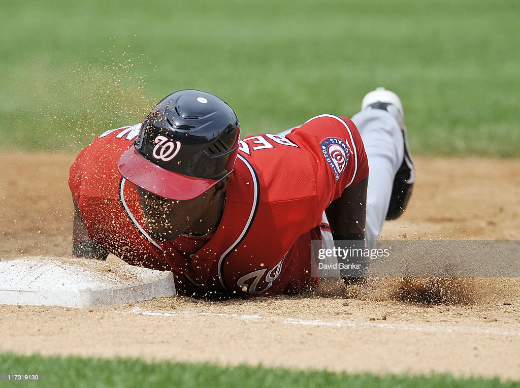 Roger Bernadina # 2 of the Washington Nationals dives back into first base against the Chicago White Sox on June 25, 2011 at U.S. Cellular Field in Chicago, Illinois. The White Sox defeated the Nationals 3-0.