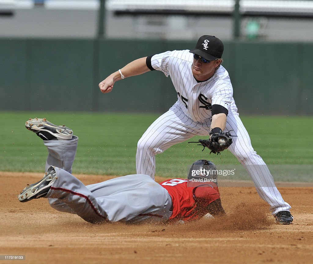 Roger Bernadina # 2 of the Washington Nationals is tagged out at second base by <a gi-track='captionPersonalityLinkClicked' href=/galleries/search?phrase=Gordon+Beckham&family=editorial&specificpeople=5411079 ng-click='$event.stopPropagation()'>Gordon Beckham</a> #15 of the Chicago White Sox on June 25, 2011 at U.S. Cellular Field in Chicago, Illinois. The White Sox defeated the Nationals 3-0.