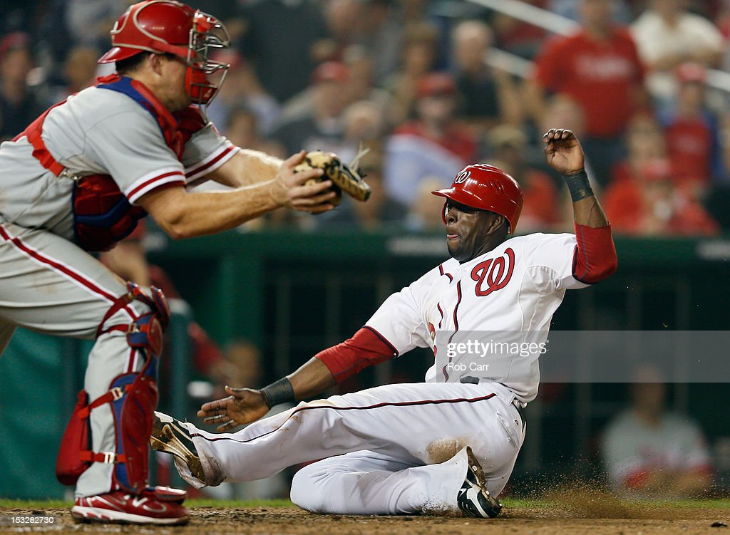 <a gi-track='captionPersonalityLinkClicked' href=/galleries/search?phrase=Roger+Bernadina&family=editorial&specificpeople=4246414 ng-click='$event.stopPropagation()'>Roger Bernadina</a> #2 of the Washington Nationals scores a run as catcher Erik Kratz #31 of the Philadelphia Phillies waits to apply the late tag during the eighth inning of the Nationals 4-2 win at Nationals Park on October 2, 2012 in Washington, DC.