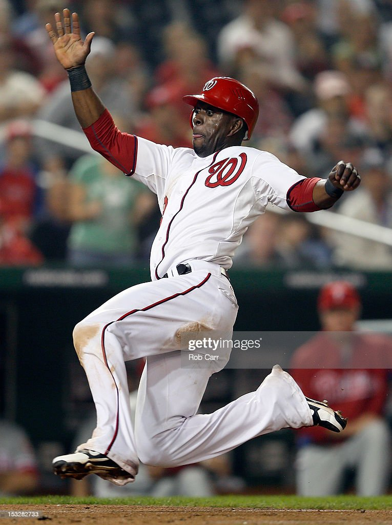 <a gi-track='captionPersonalityLinkClicked' href=/galleries/search?phrase=Roger+Bernadina&family=editorial&specificpeople=4246414 ng-click='$event.stopPropagation()'>Roger Bernadina</a> #2 of the Washington Nationals slides into home plate to score a run against the Philadelphia Phillies during the eighth inning of the Nationals 4-2 win at Nationals Park on October 2, 2012 in Washington, DC.