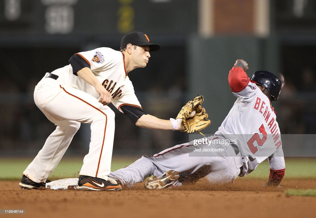 Roger Bernadina #2 of the Washington Nationals steals second base in the sixth inning as Freddy Sanchez #21 of the San Francisco Giants makes the tag during an MLB game at AT&T Park on June 7, 2011 in San Francisco, California.