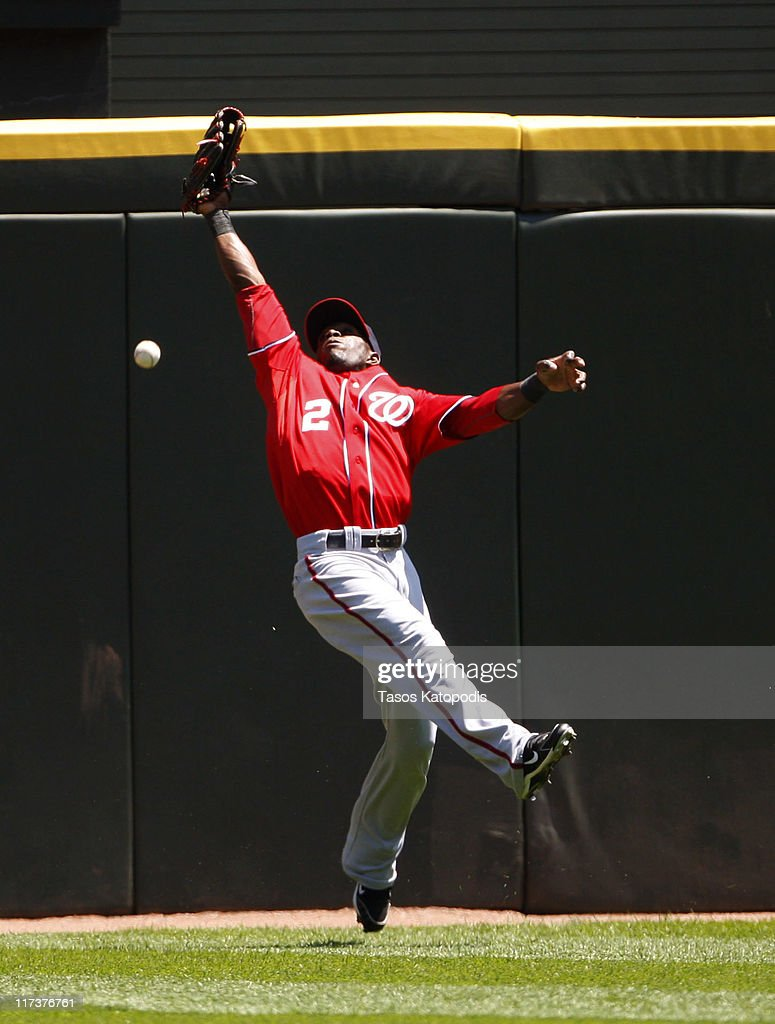 Roger Bernadina #2 Washington Nationals tries to make a catch against the Chicago White Sox on June 26, 2011 at U.S. Cellular Field in Chicago, Illinois.