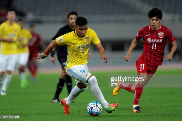 Roger Beyker Martinez of China's Jiangsu FC controls the ball during their AFC Champions League round of 16 football match against China's Shanghai...