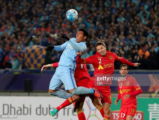 Roger Beyker Martinez of China's Jiangsu FC fights for the ball with Michael Marrone of Australia's Adelaide United during their AFC Champions League...
