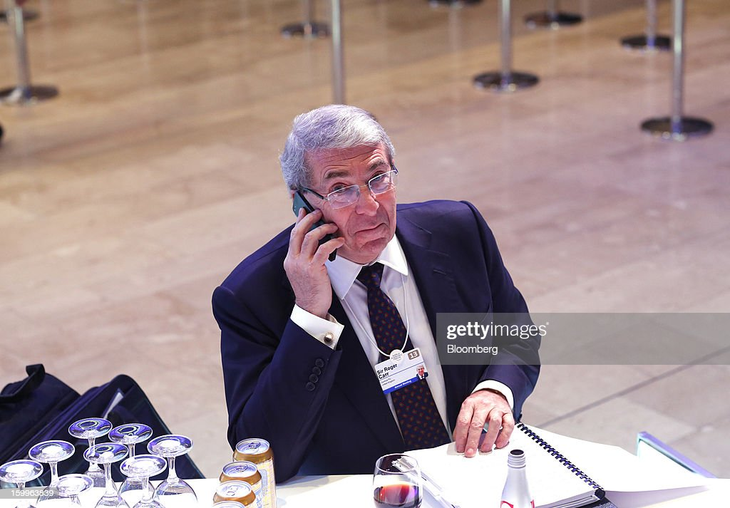 Roger Carr, president of the Confederation of British Industry (CBI), speaks on his mobile phone during a break in sessions on the opening day of the World Economic Forum (WEF) in Davos, Switzerland, on Wednesday, Jan. 23, 2013. World leaders, influential executives, bankers and policy makers attend the 43rd annual meeting of the World Economic Forum in Davos, the five day event runs from Jan. 23-27. Photographer: Simon Dawson/Bloomberg via Getty Images
