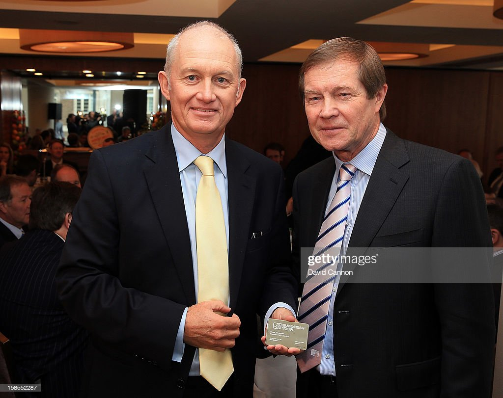 Roger Chapman of England receives his Life Membership of The European Tour from George O'Grady the Chief Executive of The European Tour during the European Tour Golfer of the Year lunch at the Royal Lancaster Hotel on December 18, 2012 in London, England.