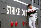 Roger Clemens of the Boston Red Sox poses against the scoreboard in May 1986 commemorating his 20 strike out game against the Seattle Mariners on...