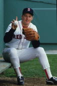 Roger Clemens of the Boston Red Sox poses against the scoreboard in May 1986 with ball commemorating his 20 strike out game against the Seattle...