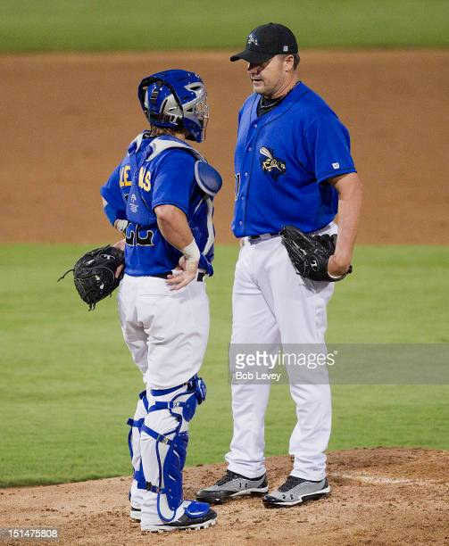 Roger Clemens of the Sugar Land Skeeters talks with his catcher Koby Clemens in the third inning against the Long Island Ducks on September 7 2012 in...