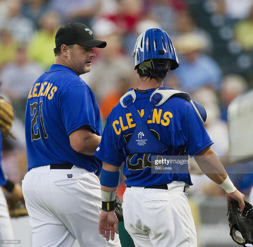<a gi-track='captionPersonalityLinkClicked' href=/galleries/search?phrase=Roger+Clemens&family=editorial&specificpeople=171089 ng-click='$event.stopPropagation()'>Roger Clemens</a> #21 of the Sugar Land Skeeters talks with son Koby Clemens #22 as they walk off the field after retiring the side against the Long Island Ducks on September 7, 2012 in Sugar Land, Texas.