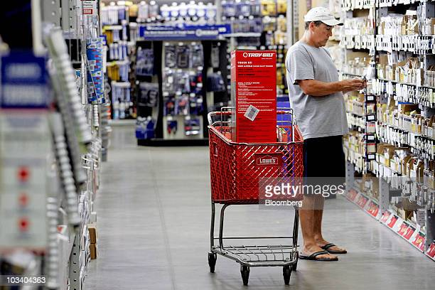 Roger Clemons shops for a light switch at a Lowe's store in Wake Forest North Carolina US on Saturday Aug 14 2010 Lowe's Cos the secondlargest US...