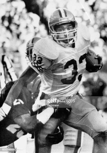 Roger Craig breaks a 26 yard run and is brought down by Rickey Dixon in the 3rd quarter action here 12/9 as the 49ers go on to defeat the Bengals...