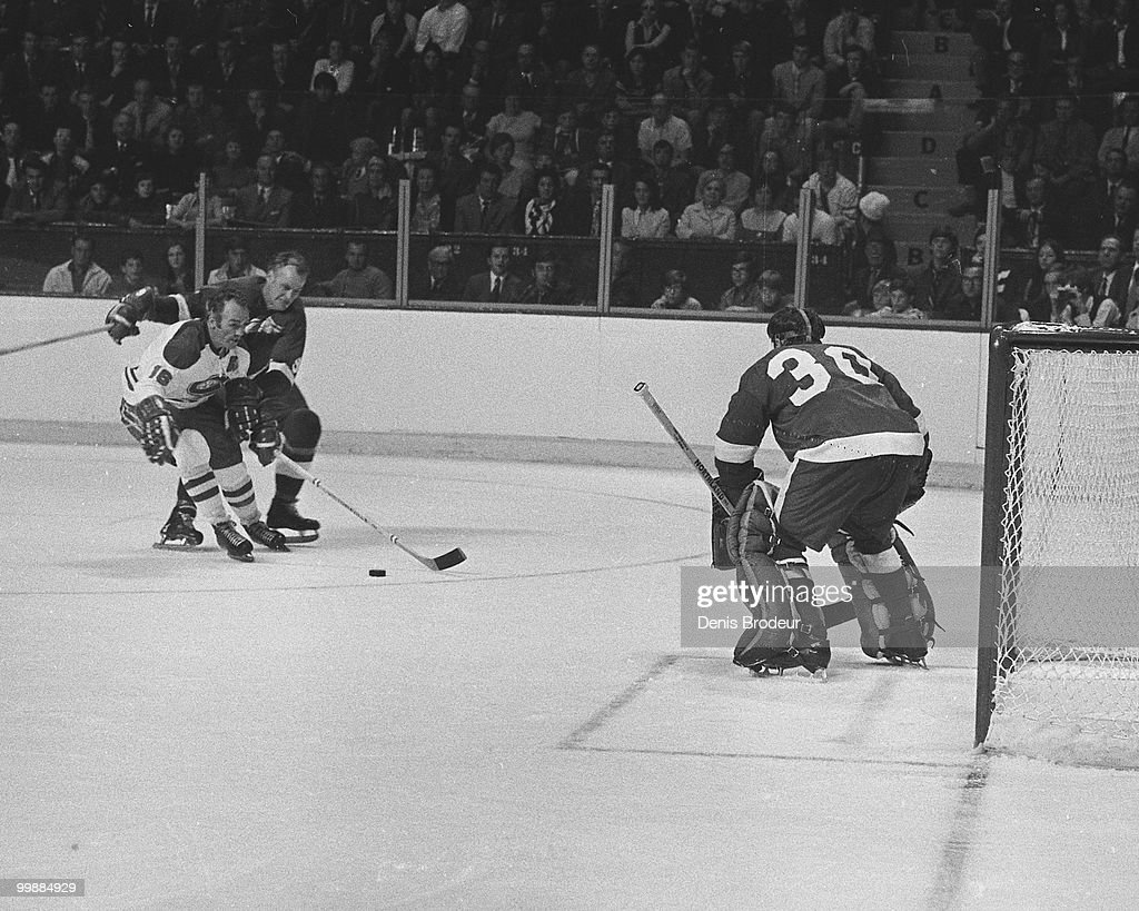 Roger Crozier protects the net while Gordie Howe of the Detroit Red Wings skates against Henri Richard of the Montreal Canadiens in 1965 at the...