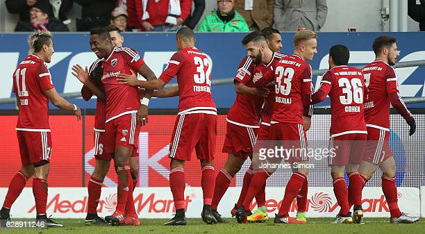 Roger de Oliveira Bernardo of Ingolstadt celebrates with team mates after scoring his team's first goal during the Bundesliga match between FC...