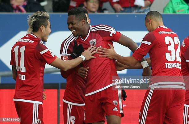 Roger de Oliveira Bernardo of Ingolstadt celebrates with team mates Dario Lezcano Farina and Marcel Tisserand after scoring his team's first goal...
