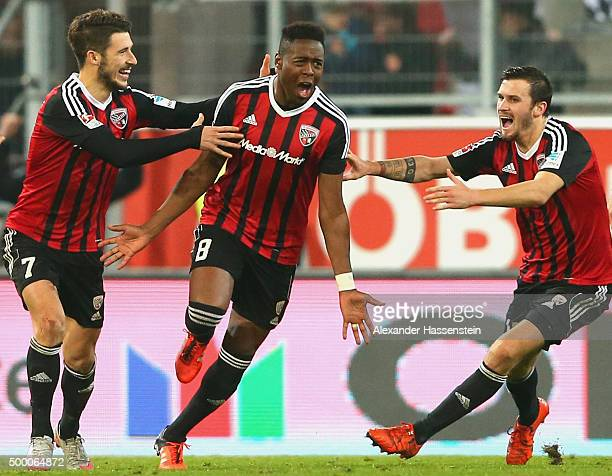 Roger de Oliveira Bernardo of Ingolstadt elebrates scoring the opening goal with his team mates Pascal Gross and Mathew Lecki during the Bundesliga...