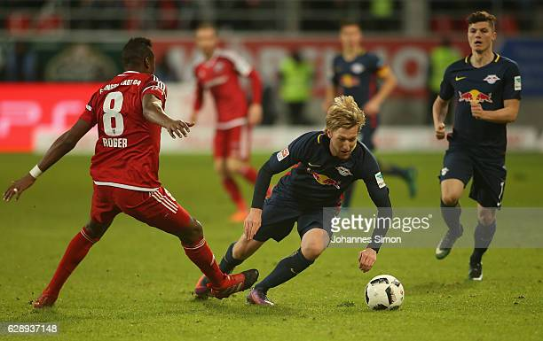 Roger de Oliveira Bernardo of Ingolstadt fights for the ball with Emil Forsberg of Leipzig during the Bundesliga match between FC Ingolstadt 04 and...