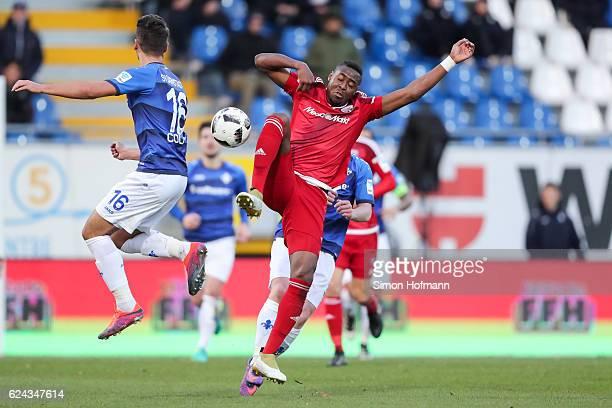 Roger de Oliveira Bernardo of Ingolstadt is challenged by Antonio Colak of Darmstadt during the Bundesliga match between SV Darmstadt 98 and FC...