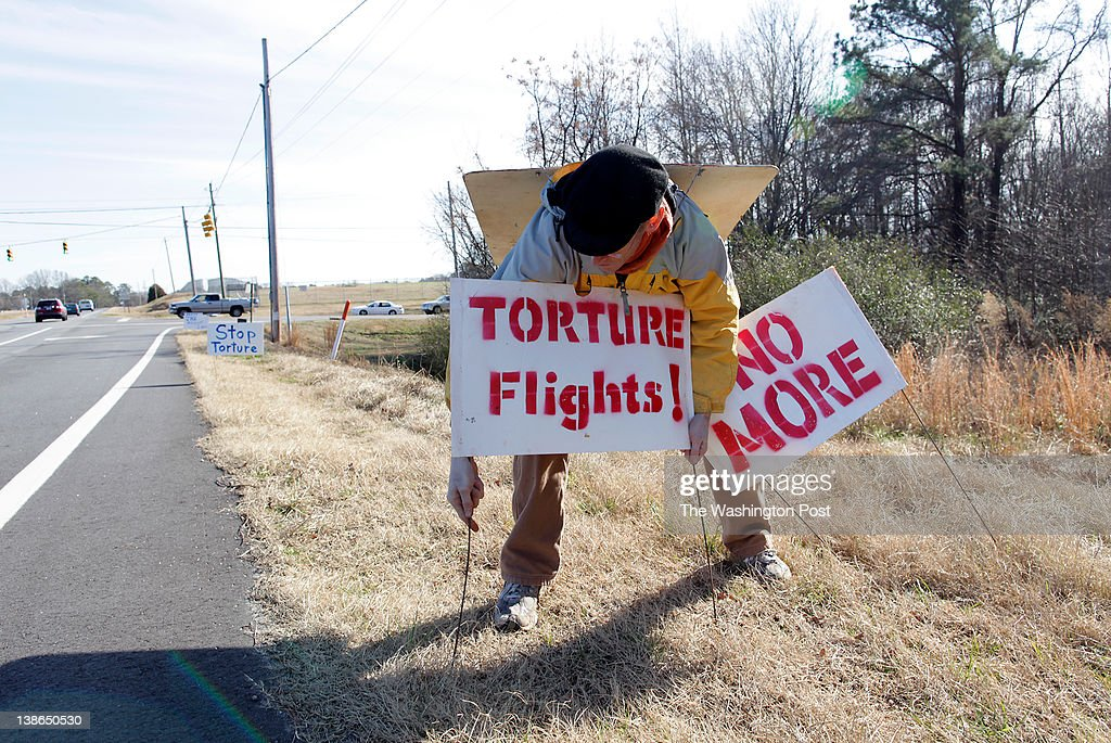 Roger Ehrlich places signs along the highway in Smithfield NC advertising a press conference and protest of rendition flights at nearby Johnston...