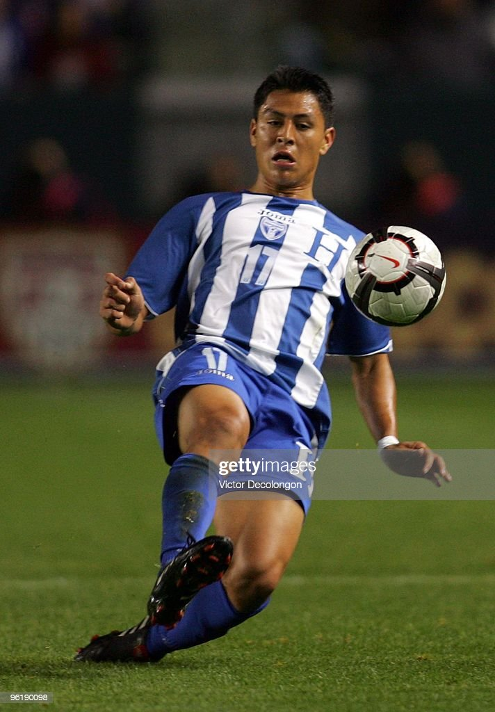 <a gi-track='captionPersonalityLinkClicked' href=/galleries/search?phrase=Roger+Espinoza&family=editorial&specificpeople=4824201 ng-click='$event.stopPropagation()'>Roger Espinoza</a> #17 of Honduras slides in to play the ball during their international friendly match against USA on January 23, 2010 in Carson, California. Honduras defeated USA