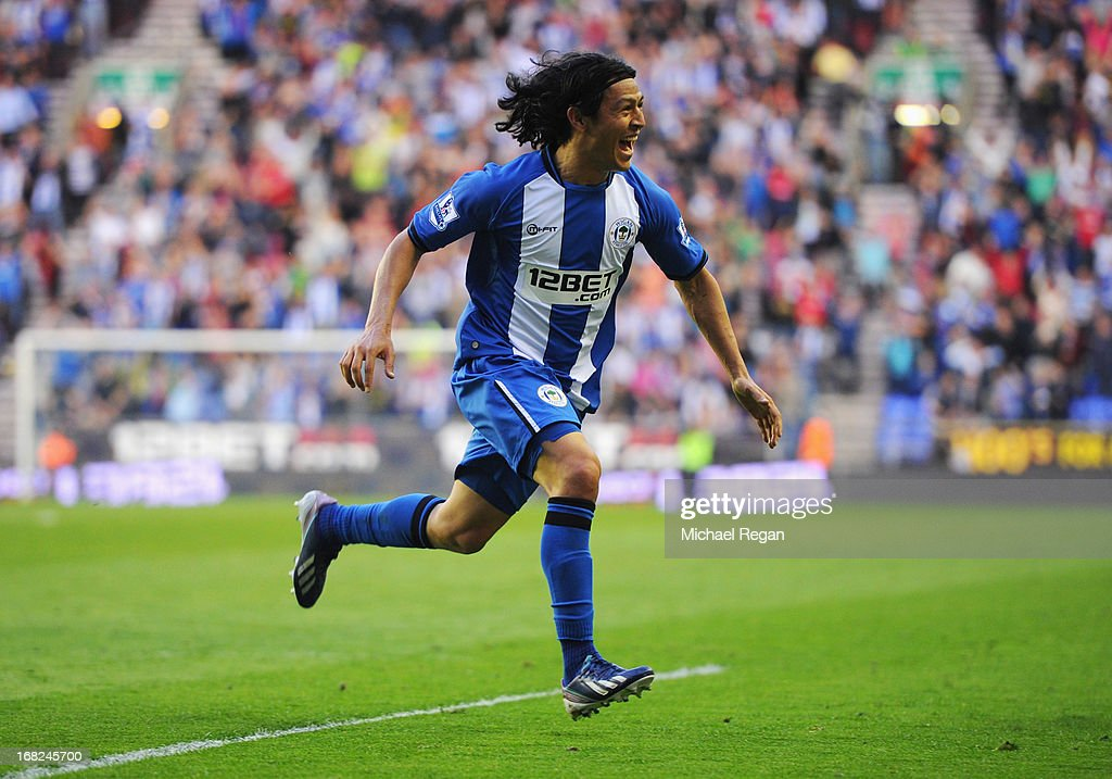 <a gi-track='captionPersonalityLinkClicked' href=/galleries/search?phrase=Roger+Espinoza&family=editorial&specificpeople=4824201 ng-click='$event.stopPropagation()'>Roger Espinoza</a> of Wigan Athletic celebrates as he scores their first goal during the Barclays Premier League match between Wigan Athletic and Swansea City at DW Stadium on May 7, 2013 in Wigan, England.