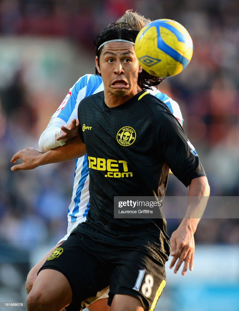 <a gi-track='captionPersonalityLinkClicked' href=/galleries/search?phrase=Roger+Espinoza&family=editorial&specificpeople=4824201 ng-click='$event.stopPropagation()'>Roger Espinoza</a> of Wigan Athletic in action during the FA Cup with Budweiser Fifth Round match between Huddersfield Town and Wigan Athletic at John Smith Stadium on February 17, 2013 in Huddersfield, England.
