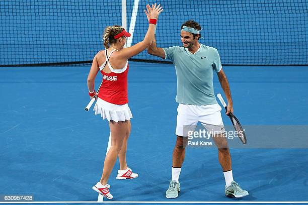 Roger Federer and Belinda Bencic of Switzerland celebrate after winning a point during the mixed doubles match against Alexander Zverev and Andrea...
