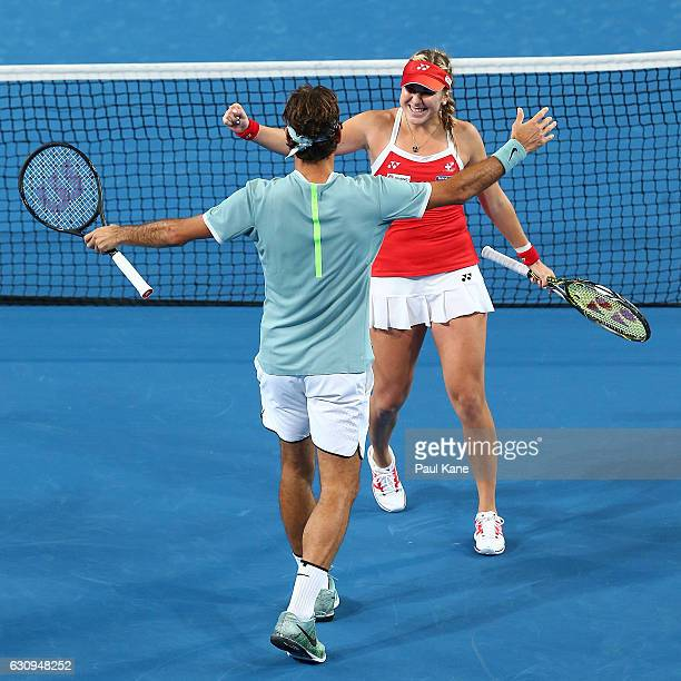 Roger Federer and Belinda Bencic of Switzerland celebrate after winning the mixed doubles match against Alexander Zverev and Andrea Petkovic of...