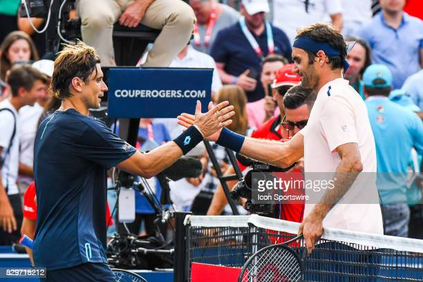 Roger Federer and David Ferrer shaking hands after their third round match at ATP Coupe Rogers on August 10 at Uniprix Stadium in Montreal QC