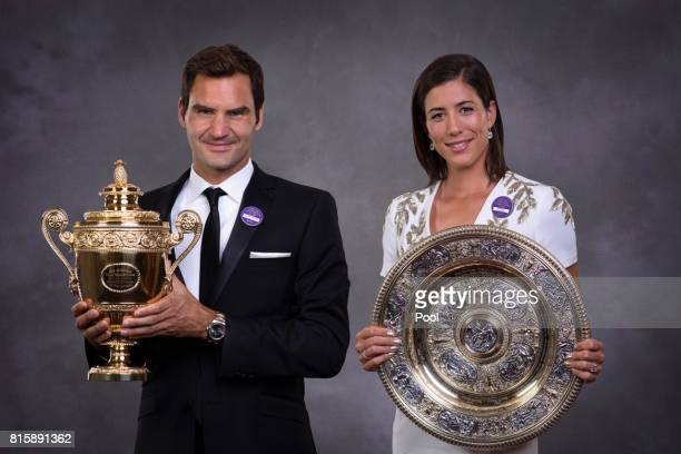 Roger Federer and Garbine Muguruza pose with their trophies at the Wimbledon Winners Dinner at The Guildhall on July 16 2017 in London England
