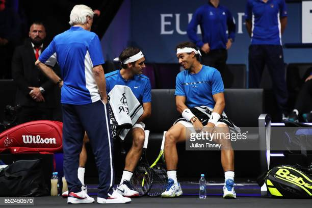 Roger Federer and Rafael Nadal of Team Europe talk tactics during there doubles match against Jack Sock and Sam Querrey of Team World on Day 2 of the...