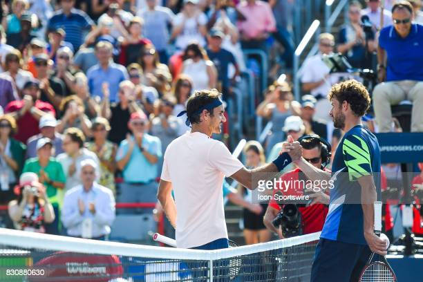 Roger Federer and Robin Haase shaking hands after their semifinal match at ATP Coupe Rogers on August 12 at Uniprix Stadium in Montreal QC