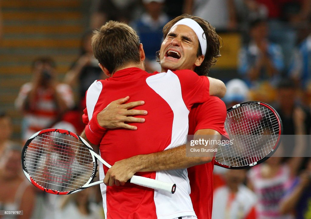 Roger Federer (right) and Stanislas Wawrinka of Switzerland celebrate after defeating Thomas Johansson and Simon Aspelin of Sweden during the men's doubles gold medal tennis match at the Olympic Green Tennis Center on Day 8 of the Beijing 2008 Olympic Games on August 16, 2008 in Beijing, China.