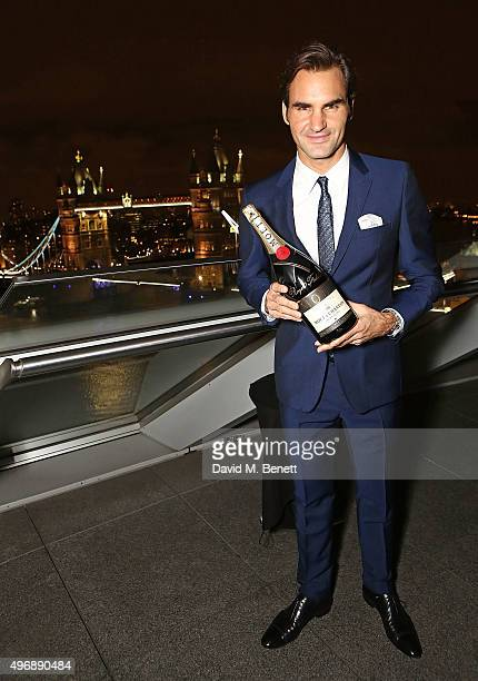 Roger Federer celebrate with Moet Chandon and raise a toast to the official launch of the 2015 Barclays ATP World Tour Finals at City Hall on...